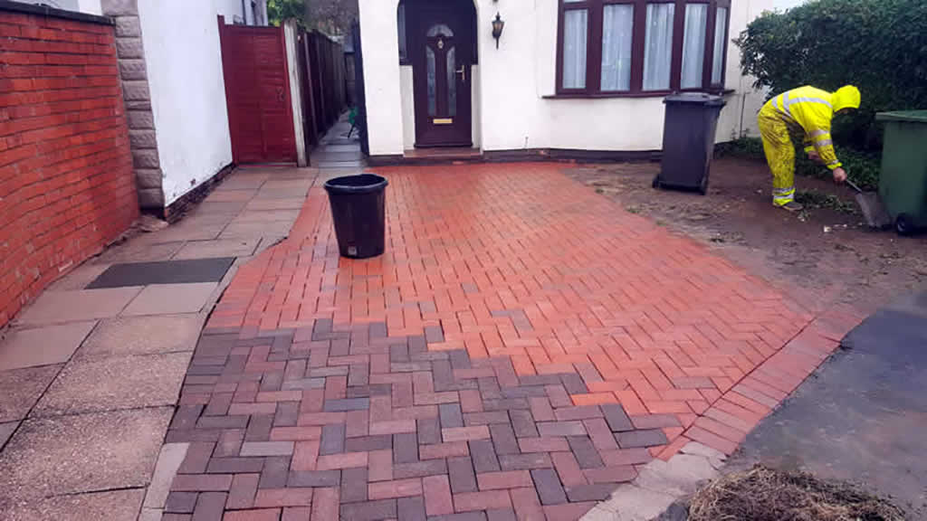 Patio and Driveway during the cleaning process